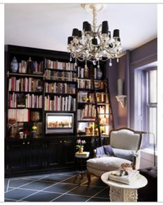 Shelves, bookcases and storage! books, bookcases, home libraries, purple, library design, offic, chandeliers, hous, homes