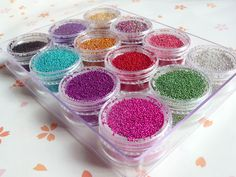 Set of Fake / Faux Candy Sprinkles Topping (w/ container as in the picture) Miniature Sweets Dessert / Cake / Cup cake Decoration Nail Art. $16.95, via Etsy.