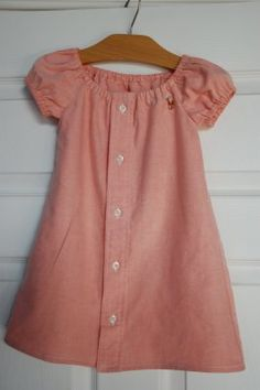Don't throw out dad's old button down shirts, recycle them into a cute little girls dress.