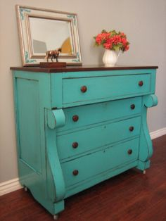 Amazing antique chunky dresser in a striking turquoise teal finish, distressed around the edges and glazed. Stained top. Rustic piece with character