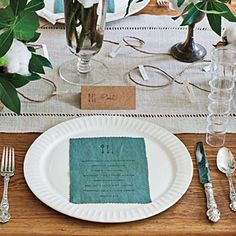 Simple Thanksgiving Table Setting | A graphic white dinner plate looks just right paired with embellished heirloom silver. | SouthernLiving.com