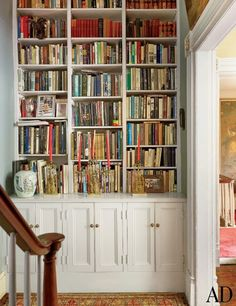 A bookcase was built into the stair hall outside the study of an antique-filled New York townhouse.