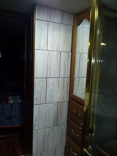 Motorhome - Tiled the bathroom wall where the mirrors used to be - still need to grout but it looks so much better