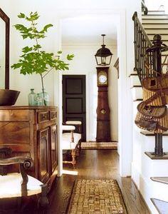 Warm wood, black door, texture, and add green