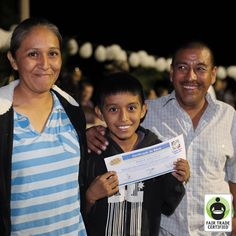 William is all smiles while receiving a #scholarship certificate thanks to a program supported by #FairTrade Funds. Click 'like' to show your support for William, a future smart leader of Fair Trade! #children #education #empowerment #improvinglives