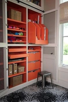 craft room/office closet with screen doors and pull out shelving.  I would choose a different color, but the idea has appeal.