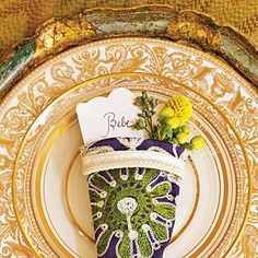 Big Easy Style Thanksgiving Table | Pile on the gold for a stunning, layered look. | SouthernLiving.com