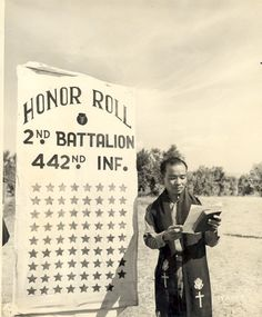 Japanese-American Chaplain Hiro Higuchi of 2nd Battalion, US 442nd Regimental Combat Team reading names of 72 fallen soldiers, Cecina area, Italy, 30 July 1944. (Hawaii War Records Depository)