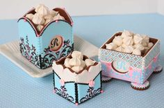 Trio of cookie boxes by Julia M. Usher. The boxes are cookies too!
