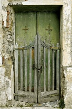 weathered green doors..... guarded by a scalloped picked gated .. respect and kindness