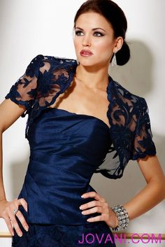 Love the color and the lace balero top. Full length skirt has the same lace overlay.