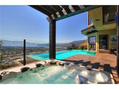 A gorgeous infinity edge pool with incredible sky and mountain views.