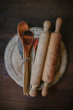 Bread Board, wooden spoons and rolling pens all made of wood all very much used.