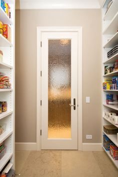 Put a glass door to the laundry room, pantry, or bedroom closet.  Beautiful.