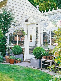 Greenhouses conservatories garden sheds on pinterest for Better homes and gardens greenhouse