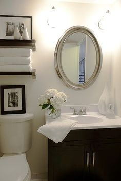 INSPIRATION; Half Bath Design. Gray walls.  Brushed and satin nickel fixtures. Thrift store mirror and silver spray paint. Espresso vanity with white ceramic counter top. Colorful rug. About $950. #diy #crafts