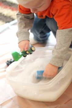 Wash up toys after being sick or indoors all winter. Simple water activity for toddlers to do.