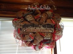 "Country deco mesh wreath. Red, burlap, western, hunting ""You can have my guns when i run out of bullets"". $110.00, via Etsy."