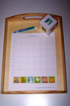 add Easter stickers to a blank die then have kids graph how many times they roll each picture