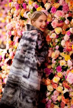 BackDrop for Photobooth ?? - Dior Garden Couture >>> runway with floor to ceiling peonies, goldenrod, dahlias, carnations and all kinds of roses. This is the behind the scene film. Just incredible. ::wall o flowers::
