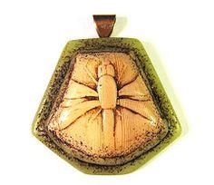 Faux bone pendant by SCDiva.
