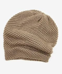 This slouchy beanie has just the right mix of texture and flop! Its double layered to keep out the chill and has a reinforced band around the inner rim to keep it in place.