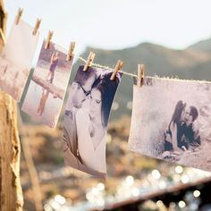 Decorating the reception with pictures... I just love the twine and clothes pins :)