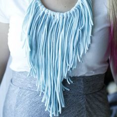 Instead of throwing out old t-shirts, reuse them and make a bohemian inspired fringe necklace.