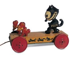 """German tinplate """"Felix and Mice' pull toy by Nifty, circa 1920s."""