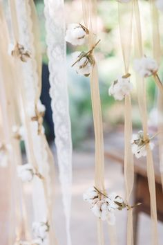 lace, cotton, and tulle streamers, photo by Michele Beckwith http://ruffledblog.com/the-notebook-inspired-wedding #garlands #weddingideas