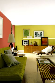 The coral accent wall gives a kick to this organic looking setup.  www.whitefence.com
