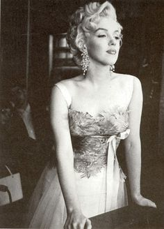 Marilyn Monroe -- had a rough life and a tragic death, and yet was always expected to be the carefree sex symbol. Vintage black&white photo of Marilyn Monroe in a beautiful strapless gown, looking out a window.  So pretty,  but so sad....