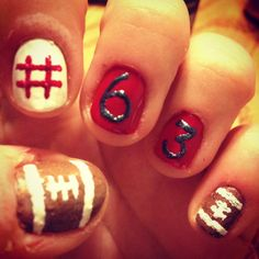 Football nails :)  i can see @breanna schultz doing this!!