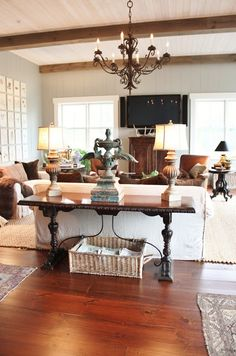 for the love of a house: the barn room, living room. Leather and white slipcovered furniture