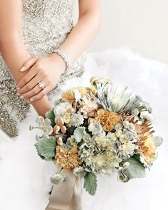 Pretty metallic neutral wedding bouquet.