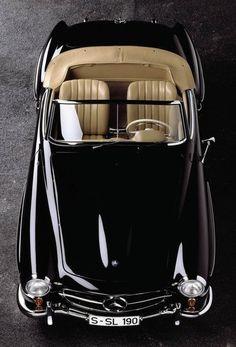 Shiny black ride convertible Mercedes w/ camel interior.