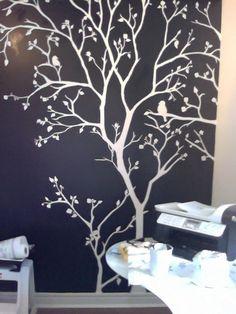 Dark wall, white tree