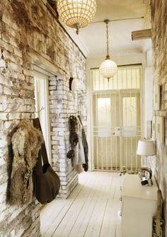 interior, rustic charm, floor, light fixtures, loft, foyer, hallway, exposed brick, entryway