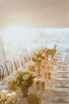 Beautiful white rose and greenery centerpieces