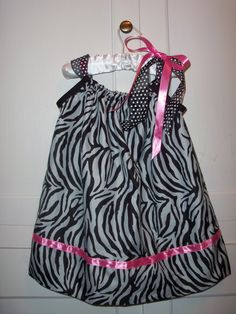 Zebra Pillowcase Dress- Made this for my friends little girl. You can find the DIY instructions at bumblebeelinens.com
