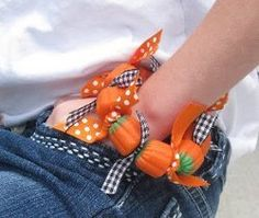 Candy jewelry is all the rage for the grade school set, so why not make these Cute Pumpkin Candy Bracelets with your kids to celebrate Halloween?