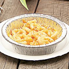 Campfire Mac 'n' Cheese   Recipes   Spoonful - precooked macaroni, whatever cheeses you want, milk and butter, disposable aluminum pan