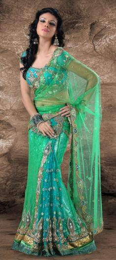 Machine embroidery work and net fabric.......New excited ranges are available in this series of lehenga style saree...  Available at-> http://www.indianweddingsaree.com/product/78728.html