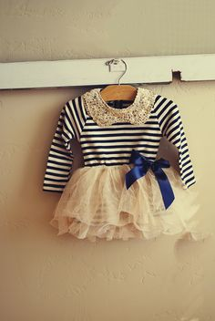 Adorable navy blue and cream striped dress with gold sequin embellished collar. Perfect Fall dress for school or party and everything in between!