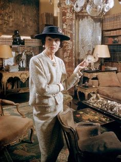 One of a few color photos of Coco Chanel, taken in her luxurious apartment.    Paris, 1959