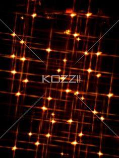 blur image of orange neon lights. - Blur image of orange neon lights over black background.