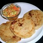 Makes 4 or 5 pupusas    Ingredients  •Masa harina -- 2 cups  •Warm water -- 1 cup  •Filling (see variations) -- 1 cup  Method  1.In a large bowl, mix together the masa harina and water and knead well. Knead in more water, one tablespoonful at a time if needed, to make a moist, yet firm dough. (It should not crack at the edges when you press down on it.) Cover and set aside to rest for 5 to 10 minutes.  2.Roll the dough into a log and cut it into 8 equal portions. Roll each portion into a ball...