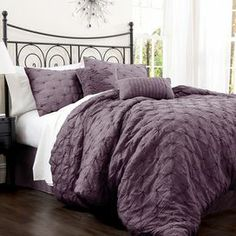 "Offering resort-chic style for your master suite, this feminine comforter set showcases a lovely embroidered motif in purple.   Product: 1 King comforter, 1 bed skirt and 2 king shamsConstruction Material: Cotton blendColor: PurpleDimensions:Comforter: 92"" x 102""King Sham: 20"" x 36""  Note: Shams do not include insertsCleaning and Care: Machine washable"