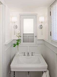 this wee one proves, wainscotting can be used in a small bathroom!  love the light grey color