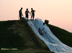 This looks fantastic - bales of hay either side on a slope. A big tarp. Lots of summer fun!  Oh I am such a big kid!